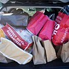 BEN GARVER — THE BERKSHIRE EAGLE<br /> Tammy Stine and Sue Pirog from South Hampton, Mass., bring the final bags from their haul at Prime outlets in Lee to their rather full SUV.