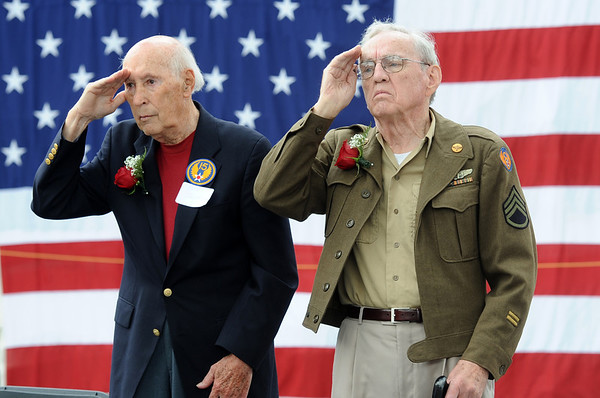 BOLDER<br /> Bill Suitts, left, and Don Mitchell stand at attention during the playing of Taps at the Memorial Day presentation during the 2011 Bolder Boulder. The two World War II veterans who were honored during the presentation.<br /> Photo by Marty Caivano/May 30, 2011