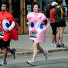 Raymond Gardner (left), of Fort Collins, and Becky Gardner (right), of  Fort Collins, run dressed as PacMan ghosts during the Bolder Boulder in Boulder, Colorado May 30, 2011.  CAMERA/Mark Leffingwell