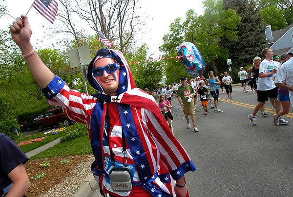 """Zach Meints goes along in patriotic colors in the 2011 Bolder Boulder race.<br /> For more photos and videos go to  <a href=""""http://www.dailycamera.com"""">http://www.dailycamera.com</a><br /> Photo by Paul Aiken  / The Boulder Camera"""