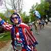 "Zach Meints goes along in patriotic colors in the 2011 Bolder Boulder race.<br /> For more photos and videos go to  <a href=""http://www.dailycamera.com"">http://www.dailycamera.com</a><br /> Photo by Paul Aiken  / The Boulder Camera"