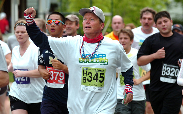 "Rick Cheever of Silverthorne, CO gives a cheer to the course photographers during the 2011 Bolder Boulder.<br /> For more photos and videos go to  <a href=""http://www.dailycamera.com"">http://www.dailycamera.com</a><br /> Photo by Paul Aiken  / The Boulder Camera"