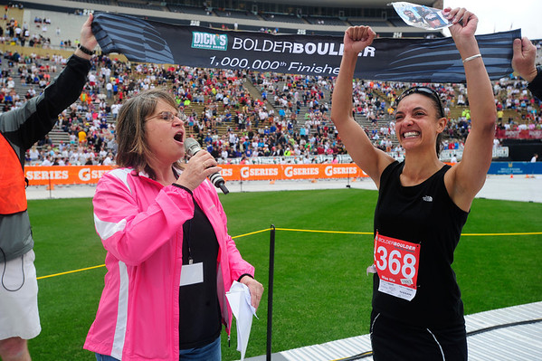 BOLDER<br /> Mieszka Laczek-Johnson, right, the one millionth finisher of the Bolder Boulder, is interviewed by Ginger, a DJ at KBCO Radio, after completing the race. Lacszek-Johnson is a veteran of the Army, who served from 2000-2005, and served in Baghdad. After recovering from a battlefield injury that left her relearning how to walk, this is her first Bolder Boulder. She lives in Denver.<br /> PHOTO BY MARTY CAIVANO<br /> May 30,, 1011