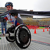 BOLDER<br /> Aaron Pike, left, pushes the finish banner out of the way as he beats Ryan Chalmers in a sprint during the 2011 Bolder Boulder wheelchair race.<br /> PHOTO BY MARTY CAIVANO<br /> May 30,, 1011