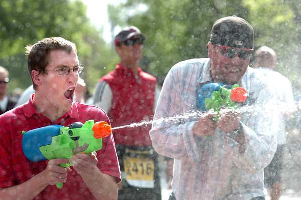 """Lucas Boyd, left and his brother Kyle soak down the runners on the 2011 Bolder Boulder course.<br /> For more photos and videos go to  <a href=""""http://www.dailycamera.com"""">http://www.dailycamera.com</a><br /> Photo by Paul Aiken  / The Boulder Camera"""