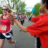 "Loretta Ganzer of Grand Junction gives a high five along the 2011 Bolder Boulder course.<br /> For more photos and videos go to  <a href=""http://www.dailycamera.com"">http://www.dailycamera.com</a><br /> Photo by Paul Aiken  / The Boulder Camera"