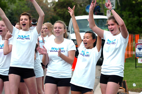 "From left to right Nora O'Neil, Annabelle Henneter, Franni Yee, and Elena Filatove of the Boulder HIgh Poms cheer for runner during the 2011 Bolder Boulder.<br /> For more photos and videos go to  <a href=""http://www.dailycamera.com"">http://www.dailycamera.com</a><br /> Photo by Paul Aiken  / The Boulder Camera"