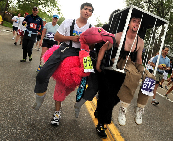 """Derek Lytle, 20, of Boulder, left, and his friend Colin Kelley, 23, of Lafayette, run while dressed in costumes during the Bolder Boulder 10K Race on Monday, May 30, in Boulder. For more photos and video of the Bolder Boulder go to  <a href=""""http://www.dailycamera.com"""">http://www.dailycamera.com</a><br /> Jeremy Papasso/ Camera"""