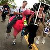 "Derek Lytle, 20, of Boulder, left, and his friend Colin Kelley, 23, of Lafayette, run while dressed in costumes during the Bolder Boulder 10K Race on Monday, May 30, in Boulder. For more photos and video of the Bolder Boulder go to  <a href=""http://www.dailycamera.com"">http://www.dailycamera.com</a><br /> Jeremy Papasso/ Camera"