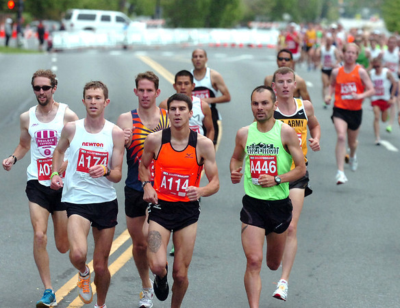 """Jeremy Freed, left,  winner of the men's citizen title, runs with Patrick Rizzo, center and Michael Aish, right in the 2011 Bolder Boulder.<br /> For more photos and videos go to  <a href=""""http://www.dailycamera.com"""">http://www.dailycamera.com</a><br /> Photo by Paul Aiken  / The Boulder Camera"""