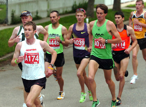 "Jeremy Freed, left,  winner of the men's citizen title, runs with Patrick Rizzo, center and Michael Aish, right in the 2011 Bolder Boulder.<br /> For more photos and videos go to  <a href=""http://www.dailycamera.com"">http://www.dailycamera.com</a><br /> Photo by Paul Aiken  / The Boulder Camera"
