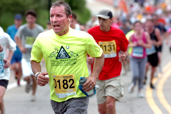 """David Ostrand of Louisville, Co runs up the last hill to Folsom Field near the end of  2011 Bolder Boulder course.<br /> For more photos and videos go to  <a href=""""http://www.dailycamera.com"""">http://www.dailycamera.com</a><br /> Photo by Paul Aiken  / The Boulder Camera"""