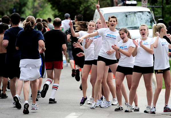 (Left to right) Haley Davis, Leanna Laudis, Nora O'Neil, Elena Filatova, Annabella Hemmeter and Leslie Dehaas, all with Boulder High School Poms, cheer on the runners during the Bolder Boulder in Boulder, Colorado May 30, 2011.  CAMERA/Mark Leffingwell