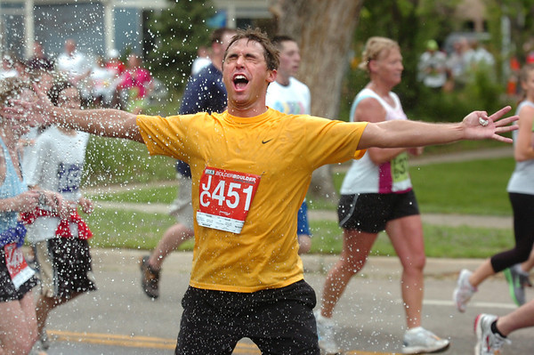 """Michael ArendDenver, Co asks to be blasted with water during the 2011 Bolder Boulder.<br /> For more photos and videos go to  <a href=""""http://www.dailycamera.com"""">http://www.dailycamera.com</a><br /> Photo by Paul Aiken  / The Boulder Camera"""