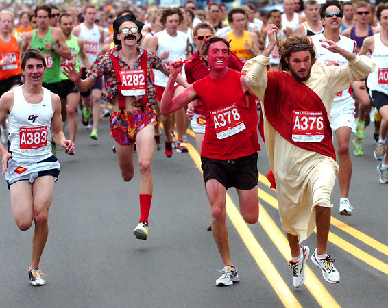 """From left to right Creighton Rauh, Jon Johannsen, Daniel Peacock as the devil and Chris Davis as Jesus during start of the 2011 Bolder Boulder.<br /> For more photos and videos go to  <a href=""""http://www.dailycamera.com"""">http://www.dailycamera.com</a><br /> Photo by Paul Aiken  / The Boulder Camera"""