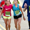 "Kendra Gerk,left and Kelly Bush of Greeley, CO help each other up the last hill to Folsom Field near the end of  2011 Bolder Boulder course.<br /> For more photos and videos go to  <a href=""http://www.dailycamera.com"">http://www.dailycamera.com</a><br /> Photo by Paul Aiken  / The Boulder Camera"
