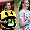 Bruce Holbert, of Fort Collins, runs dressed as PacMan during the Bolder Boulder in Boulder, Colorado May 30, 2011.  CAMERA/Mark Leffingwell