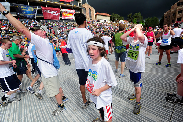 BOLDER<br /> Michael Blackburn, right, along with his sons Micah, 9, center, and Asher, 13, right, wait for other runners at the finish line of the 2011 Bolder Boulder.<br /> PHOTO BY MARTY CAIVANO<br /> May 30,, 1011