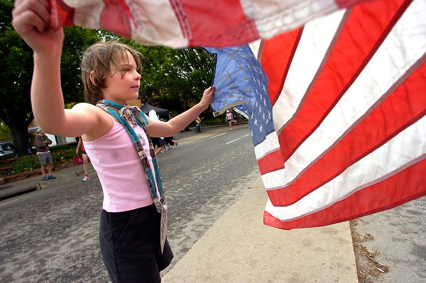 "Elise Jongejan, 7, or Northglenn, waves a US flag as she cheers runners along the 2011 Bolder Boulder course.<br /> For more photos and videos go to  <a href=""http://www.dailycamera.com"">http://www.dailycamera.com</a><br /> Photo by Paul Aiken  / The Boulder Camera"