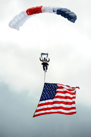 BOLDER<br /> Chris Smith of Mile High Skydiving brings the American flag into Folsom Field during the Memorial Day presentation at the 2011 Bolder Boulder. <br /> Photo by Marty Caivano/May 30, 2011