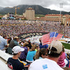 "Chuck Blish, 44, of Arvada, sits in the stands of Folsom Field with american flags tucked in his hat during the Bolder Boulder 10K Race on Monday, May 30, in Boulder. For more photos and video of the Bolder Boulder go to  <a href=""http://www.dailycamera.com"">http://www.dailycamera.com</a><br /> Jeremy Papasso/ Camera"