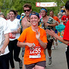 """Jesse Stern of Boulder runs with Hannah Scharf of Watertown, WI during the 2011 Bolder Boulder.<br /> For more photos and videos go to  <a href=""""http://www.dailycamera.com"""">http://www.dailycamera.com</a><br /> Photo by Paul Aiken  / The Boulder Camera"""
