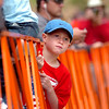 "Logan Taylor, 7, of Lubbock Texas, looks for his dad who is running near the end of  2011 Bolder Boulder course.<br /> For more photos and videos go to  <a href=""http://www.dailycamera.com"">http://www.dailycamera.com</a><br /> Photo by Paul Aiken  / The Boulder Camera"
