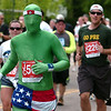 "David Marucheau, of Fort Collins, CO runs as a green man, during the 2011 Bolder Boulder.<br /> For more photos and videos go to  <a href=""http://www.dailycamera.com"">http://www.dailycamera.com</a><br /> Photo by Paul Aiken  / The Boulder Camera"