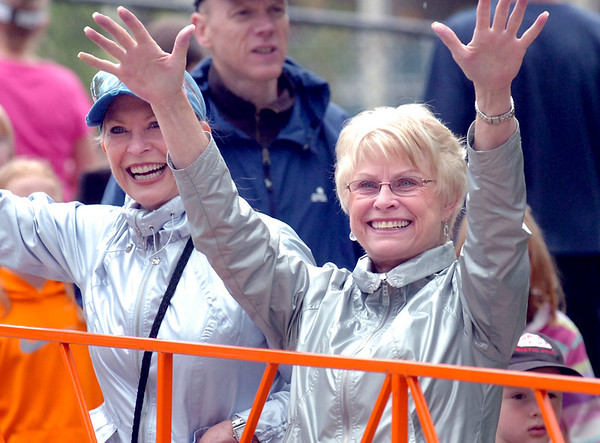 """From left to right, Nancy Strand and  Judy Ficke cheer as Ficke's daugher Susan runs by near the end of  2011 Bolder Boulder course.<br /> For more photos and videos go to  <a href=""""http://www.dailycamera.com"""">http://www.dailycamera.com</a><br /> Photo by Paul Aiken  / The Boulder Camera"""