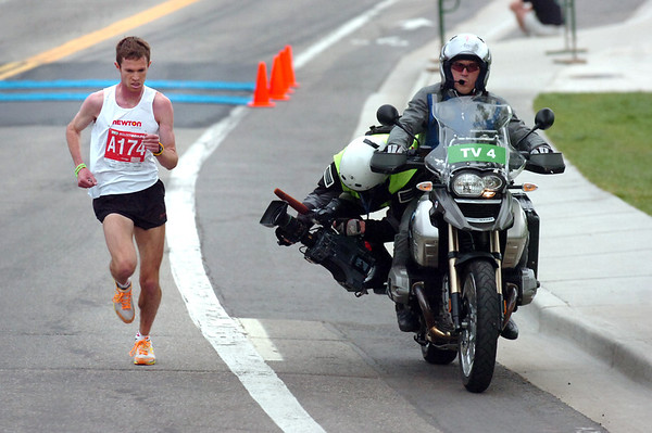 """Jeremy Freed winner of the men's citizen title in the 2011 Bolder Boulder runs away from the field. <br /> For more photos and videos go to  <a href=""""http://www.dailycamera.com"""">http://www.dailycamera.com</a><br /> Photo by Paul Aiken  / The Boulder Camera"""