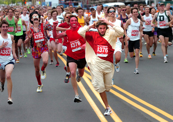 """Daniel Peacock as the devil chases Chris Davis playing Jesus during start of the 2011 Bolder Boulder.<br /> For more photos and videos go to  <a href=""""http://www.dailycamera.com"""">http://www.dailycamera.com</a><br /> Photo by Paul Aiken  / The Boulder Camera"""
