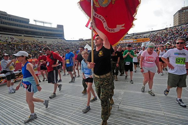 BOLDER<br /> The University of Colorado based Marine Corps cross the finish line in the 2011 Bolder Boulder.<br /> PHOTO BY MARTY CAIVANO<br /> May 30,, 1011
