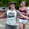 "Patricia Wallace Wright of Boulder, runs through a water spray during the 2011 Bolder Boulder.<br /> For more photos and videos go to  <a href=""http://www.dailycamera.com"">http://www.dailycamera.com</a><br /> Photo by Paul Aiken  / The Boulder Camera"