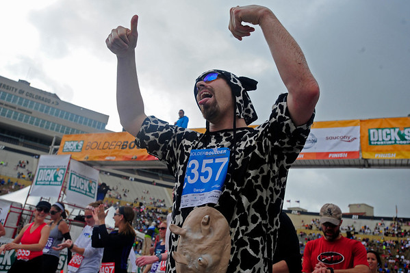 BOLDER<br /> Danger Wilson of Colorado Springs celebrates his finish of the 2011 Bolder Boulder in a cow suit.<br /> PHOTO BY MARTY CAIVANO<br /> May 30,, 1011