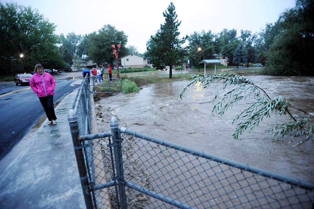 . The creek that runs along Missouri Ave in Southmoor Park in Longmont is running over its banks. For more videos and photo galleries at the plant, go to www.dailycamera.com. Cliff Grassmick  / September 12, 2013