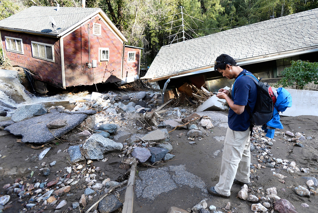 . Keenan Gates takes photos of his mother\'s destroyed house  on Tuesday, Sept. 17, in the town of Salina on Fourmile Canyon Drive in Boulder County. For more photos and video of the flood rescue go to www.dailycamera.com Jeremy Papasso/ Camera