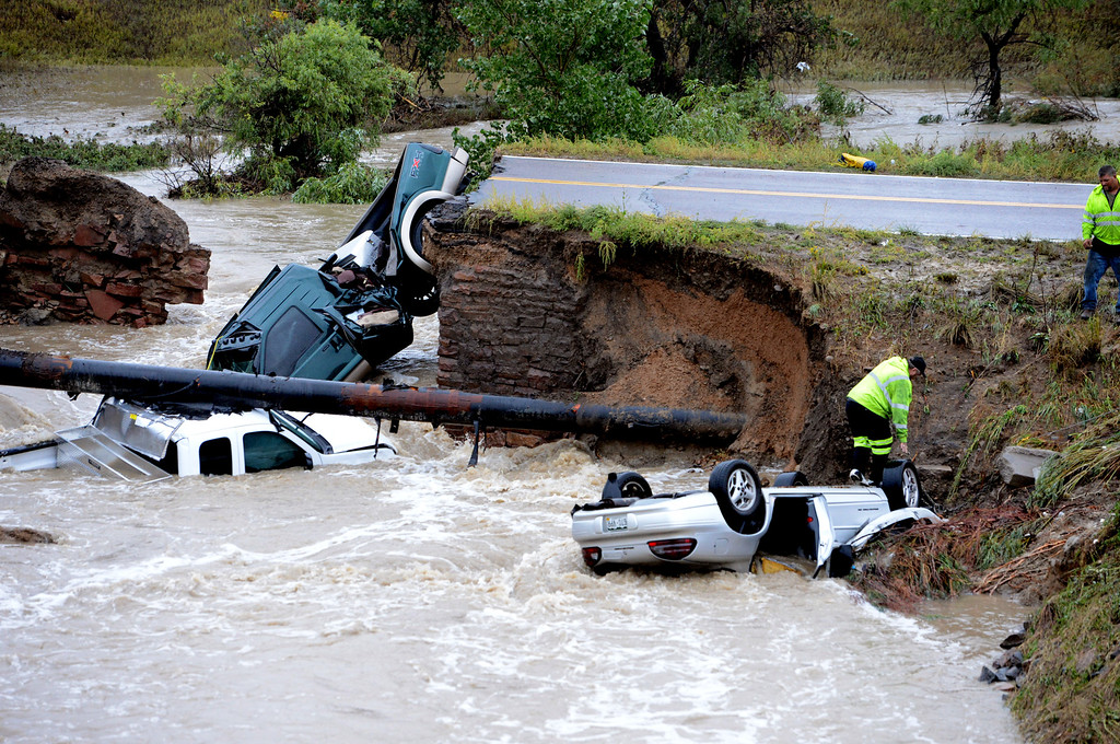. Bridge Out Car in Creek from Rain51.JPG Tow truck staff attach a cable to one of the cars. A bridge collapse on a business access road at Highway 287 and Dillon Road in Lafayette causes 3 cars to fall in the creek.Cliff Grassmick / September 12, 2013