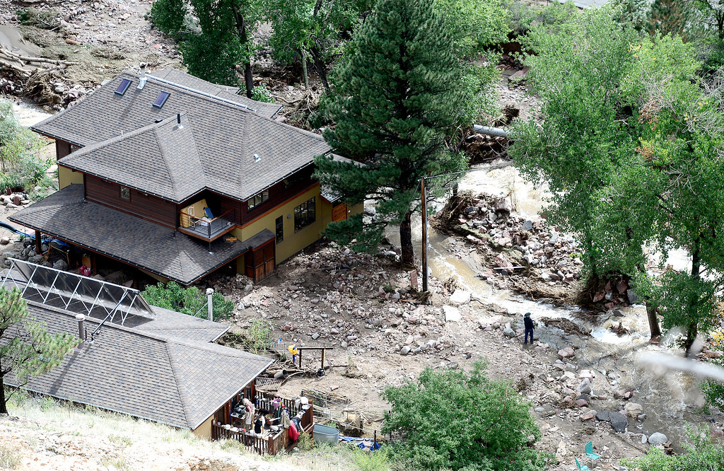 . People move around outside of their homes off Lee Hill Drive where Fourmile Canyon Creek overflowed it\'s banks in Boulder, Colorado September 16, 2013.  DAILY CAMERA/ MARK LEFFINGWELL