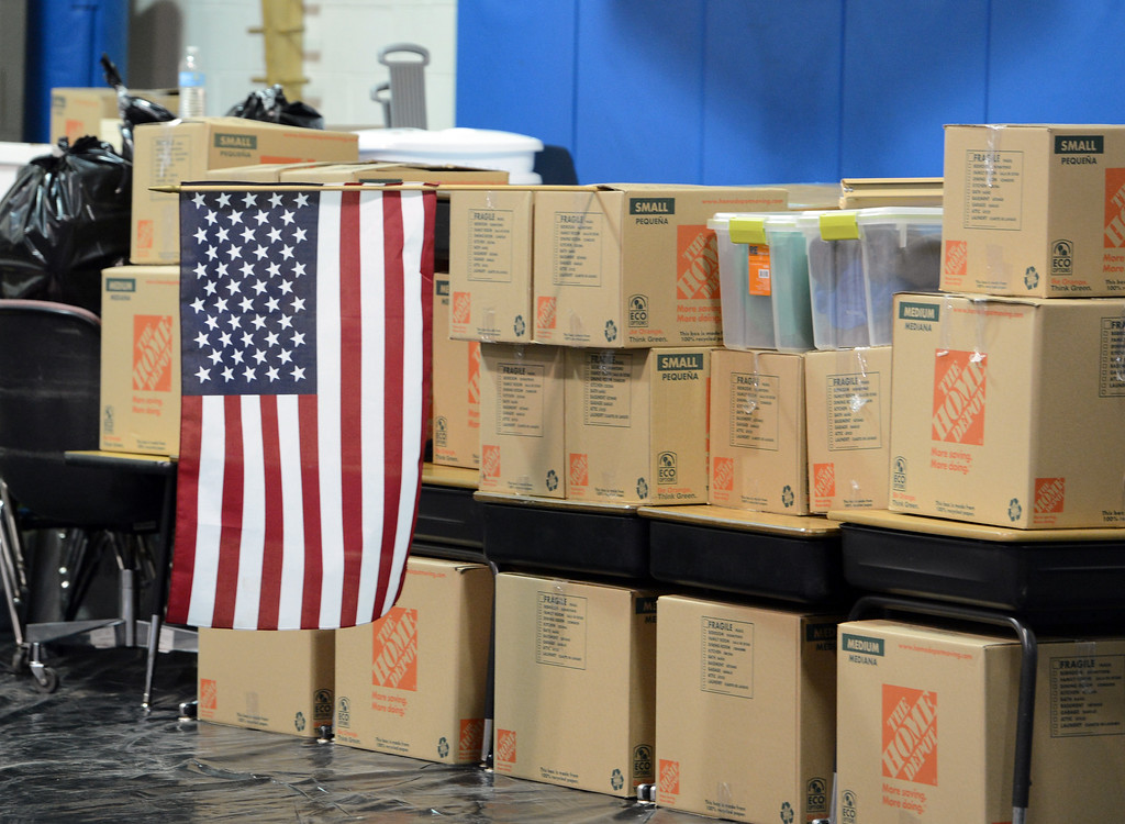 . A US Flag was put up on a stack of boxes at Crest View Elementary on Tuesday. Workers from Servpro and other disaster clean up contractors work on flood Damage at Crest View Elementary in Boulder on September 17, 2013. For more flooding videos and photos, www.dailycamera.com. Cliff Grassmick  / September 17, 2013