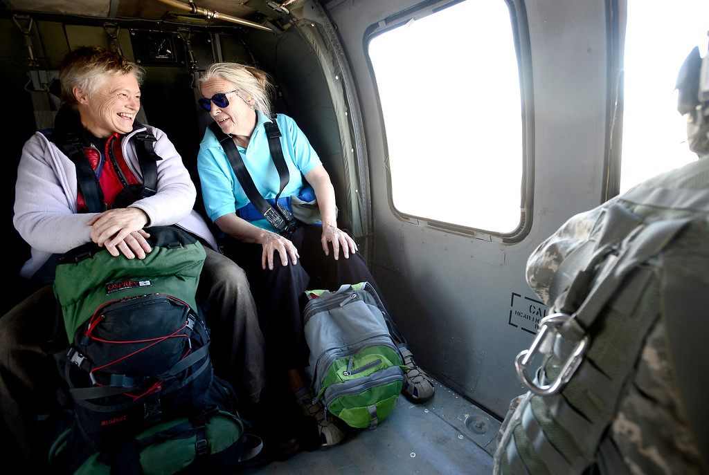 . Two women smile and laugh after rescued by a helicopter crew with the 2-4 GSAB 4th Infantry Division based in Ft. Carson near Jamestown, Colorado September 17, 2013. BOULDER DAILY CAMERA/ Mark Leffingwell