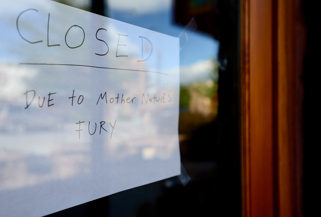 """. A sign seen on the door at Barking Dog Cafe reads \""""closed due to mother nature\'s fury,\"""" Wednesday, Sept. 18, 2013, in Lyons. (Matthew Jonas/Times-Call)"""