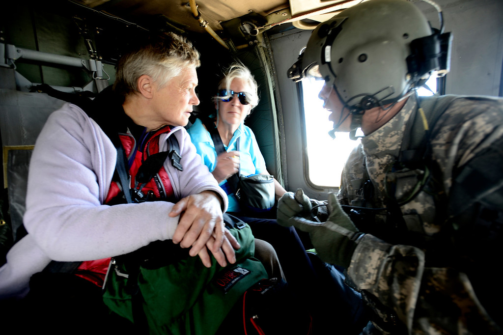 . Staff Sgt. Jose Pantoja talks with two women rescued outside Jamestown Colorado on Tuesday. The town was hard hit by flood waters.  The helicopter was flown by members of 2-4 GSAB 4th Infantry Division based in Ft. Carson, Colorado September 17, 2013. BOULDER DAILY CAMERA/ Mark Leffingwell