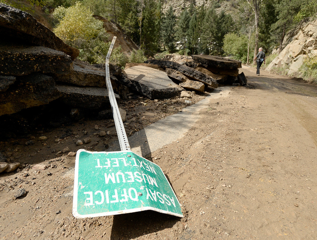 . A sign is ripped out of the ground on Tuesday, Sept. 17, on Fourmile Canyon Drive in Boulder County. For more photos and video of the flood rescue go to www.dailycamera.com Jeremy Papasso/ Camera