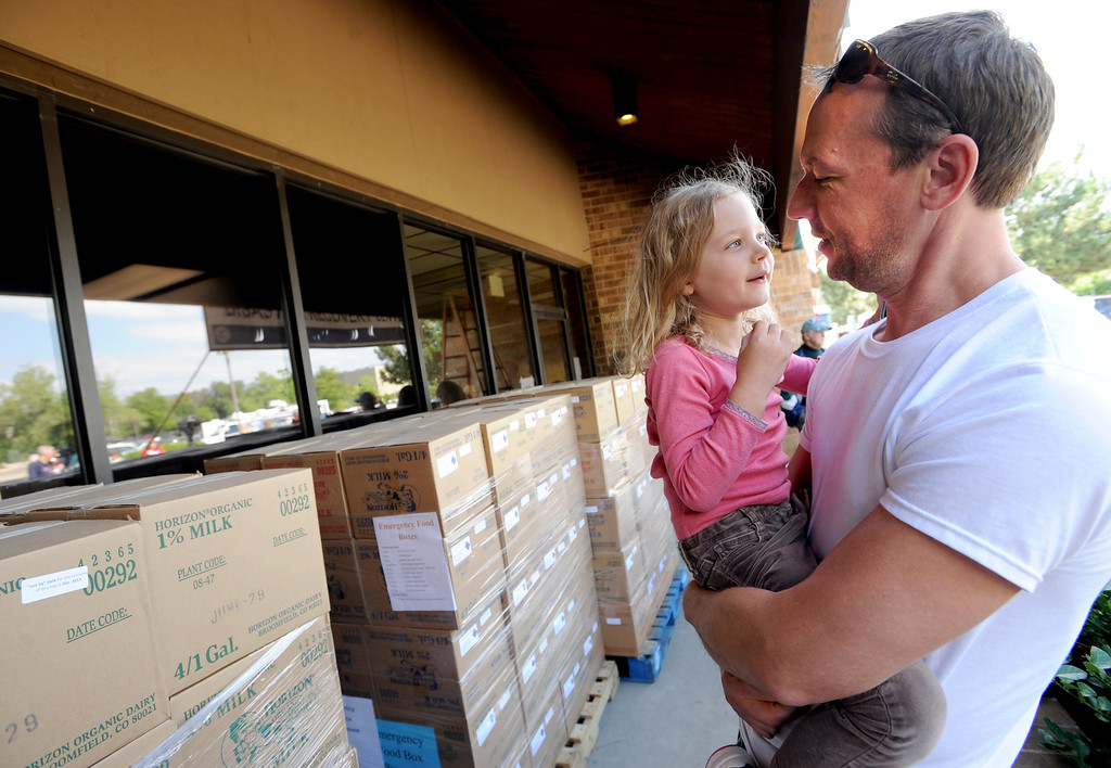 . Will Vandenberge waits with his daughter, Mia, 4, outside the disaster center on Thursday. The City of Boulder and Boulder County have opened a joint Disaster Assistance Center  on Thursday, Sept. 19, at 5495 Arapahoe Ave. in Boulder. This center, along with the Disaster Assistance Center in Longmont, is available all to Boulder County residents impacted by the flood.For more flooding videos and photos, www.dailycamera.com. Cliff Grassmick  / September 19, 2013