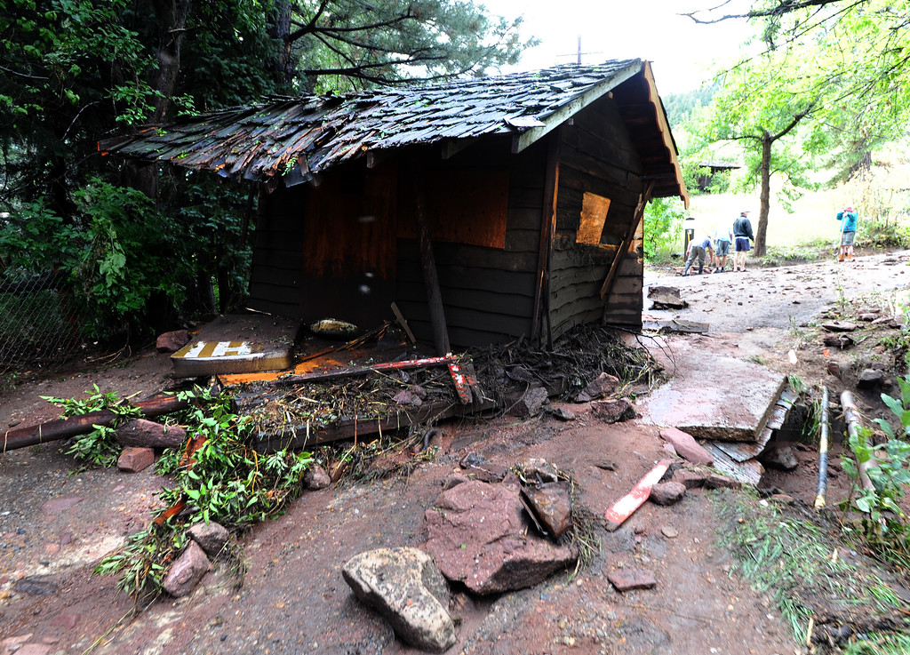 . This old wooden shack was washed down  about 100-yards from its permanent location near 3rd and Arapahoe. For more flooding videos and photos, www.dailycamera.com. Cliff Grassmick  / September 13, 2013