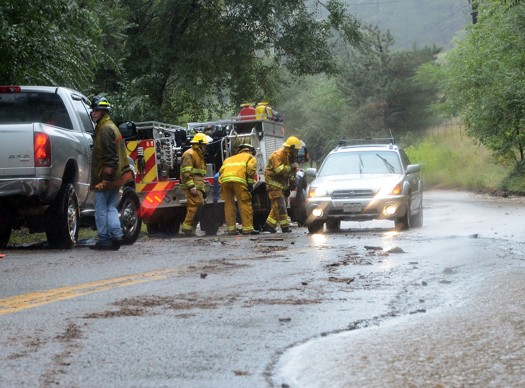 . A motorist is stopped in Sunshine Canyon on Thursday. For more flooding videos and photos, www.dailycamera.com. Cliff Grassmick  / September 12, 2013