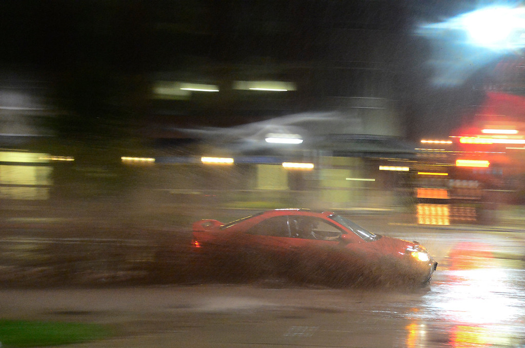 . A car is seen driving through a flooded section of Canyon, Thursday, Sept. 12, 2013, in Boulder. (Matthew Jonas/Times-Call)