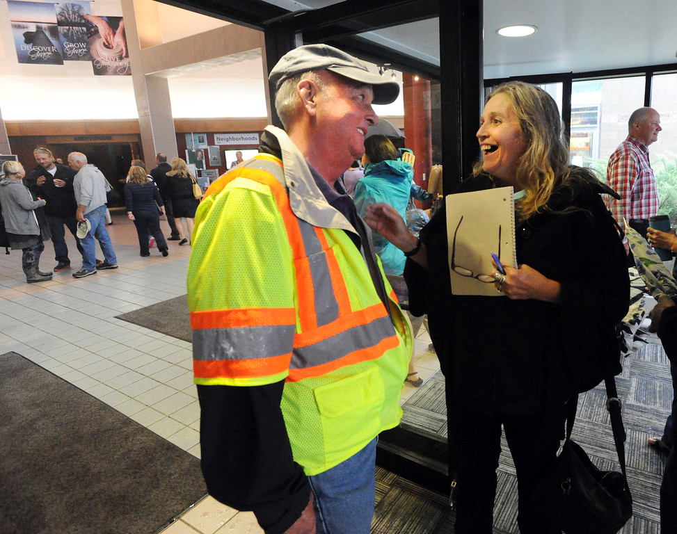 . Chris Peck greets Lori Baier at the LifeBridge Church in Longmont, Colorado on September 15, 2013. The church is providing food and  shelter to flood victims. Cliff Grassmick / September 15, 2013