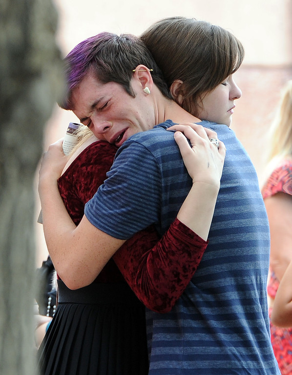 . Mourners comfort each other after the service. A memorial service for Wiyanna Nelson and Wesley Quinlan was held at NCAR in Boulder, Colorado on Saturday, September 21, 2013. The teenagers were killed in the flood waters in Boulder.  Cliff Grassmick  / September 21, 2013