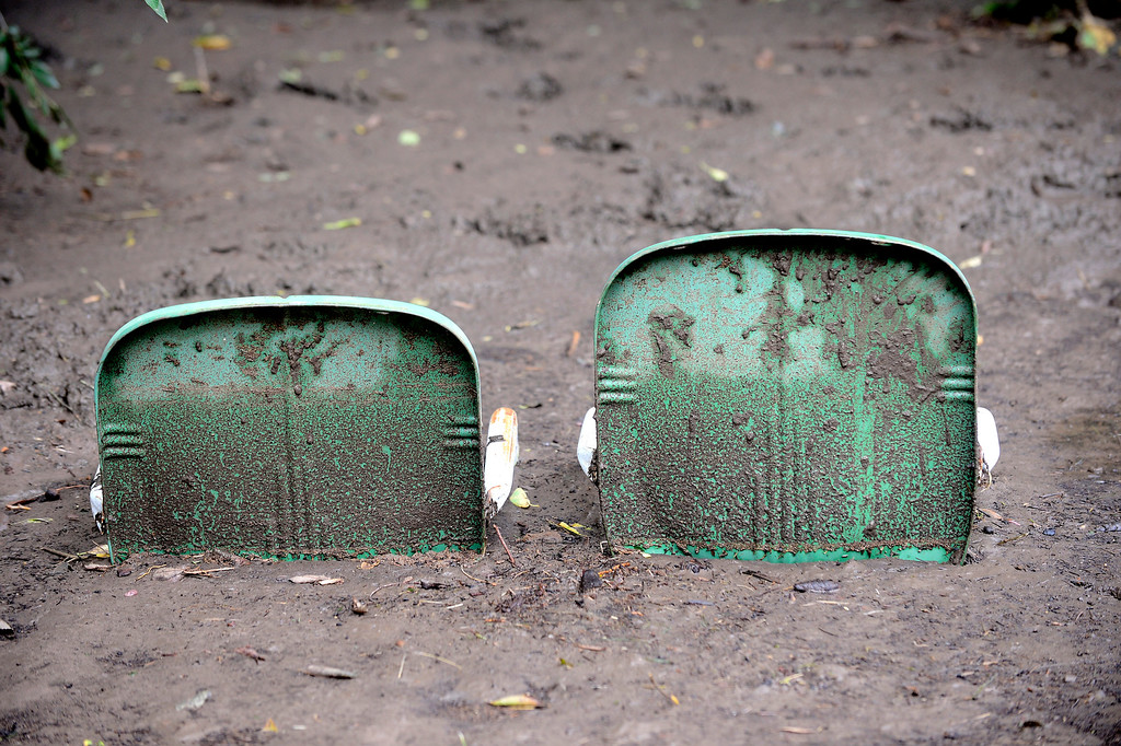 . Two chairs sit sunken in mud in Boulder, Colorado on Sunday September 15, 2013.  Rain fell heavily again today increasing fears of more flooding in the community. Photo by Paul Aiken / The Daily Camera / Saturday September 15, 2013